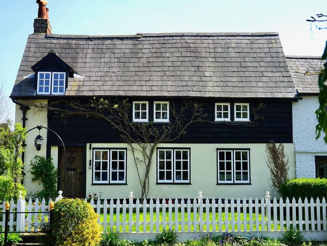 Country cottage with white picket fencing