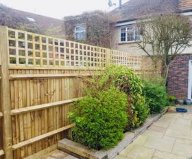 Featherboard Garden fencing including a straight top trellis