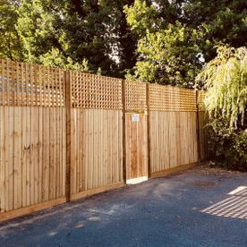 feather boarded garden fencing with top trellis and gate